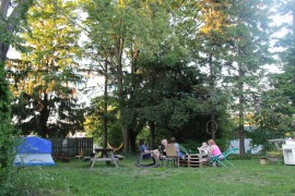 A group of guests gathering in the backyard for a post-hike hangout.